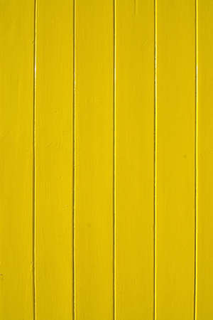 painted wood: Yellow painted wood background vertical copy space. Stock Photo