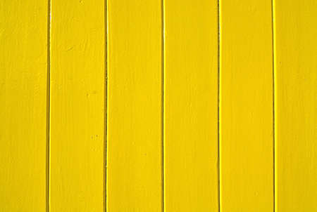 painted wood: Yellow painted wood background copy space. Stock Photo