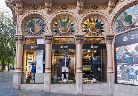 real madrid: PALMA DE MALLORCA, BALEARIC ISLANDS, SPAIN - DECEMBER 13, 2015: Real Madrid fan store window display in the beautiful Can Corbella art nouveau style building on December 13, 2015 in Palma de Mallorca, Balearic islands, Spain