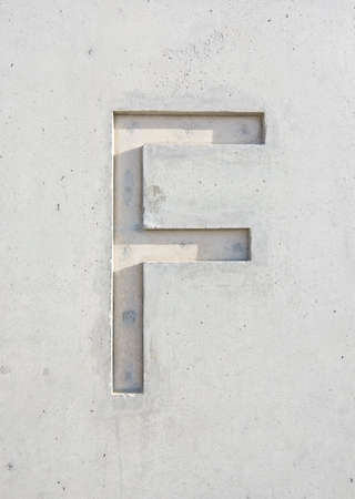 The letter 'F' cut in grayish white stone design element 写真素材