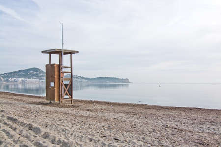 beaches of spain: Lifeguard station on empty beach on a sunny winter morning in December in Ibiza, Balearic islands, Spain