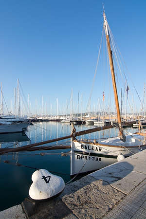 PALMA DE MALLORCA, BALEARIC ISLANDS, SPAIN - DECEMBER 22, 2015: Marina with yachts, llaut  and the word BALEAR and mooring knob with number 4 on a sunny day on December 22, 2015 in Palma de Mallorca, Balearic islands, Spain Editöryel