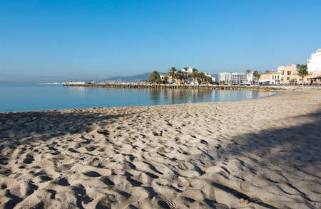 Sandy beach on a sunny day near Portixol in Mallorca, Balearic islands, Spain Stock Photo