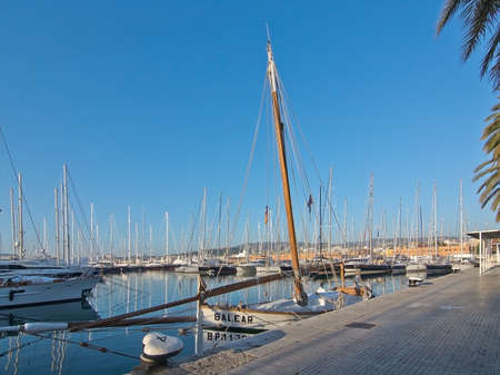 PALMA DE MALLORCA, BALEARIC ISLANDS, SPAIN - DECEMBER 22, 2015: Marina with boats and the word BALEAR and mooring knob with number 4 on a sunny day on December 22, 2015 in Palma de Mallorca, Balearic islands, Spain