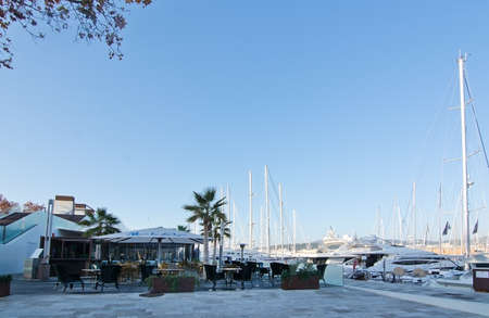 bicycling: PALMA DE MALLORCA, BALEARIC ISLANDS, SPAIN - DECEMBER 22, 2015: Palma marina and caf along the Mediterranean seaside bicycling route on a sunny day on December 22, 2015 in Palma de Mallorca, Balearic islands, Spain Editorial