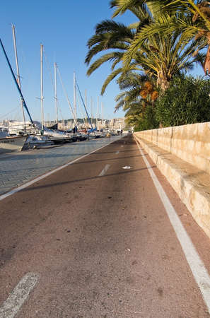 bicycling: PALMA DE MALLORCA, BALEARIC ISLANDS, SPAIN - DECEMBER 22, 2015: Seaside bicycling route along the Mediterranean on a sunny day on December 22, 2015 in Palma de Mallorca, Balearic islands, Spain