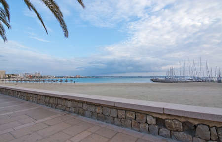 Empty sandy Playa de Palma beach and marina in Mallorca, Balearic islands, Spain