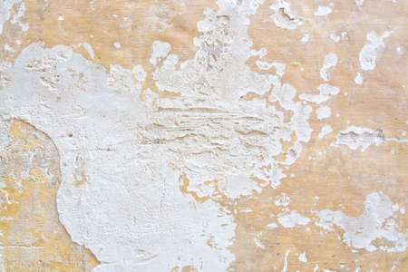 roughcast: Yellow white plaster grunge wall background or backdrop.