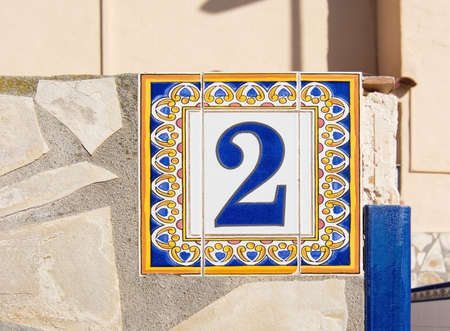 balearic: Ceramic plate with number two from Ibiza, Balearic islands, Spain Stock Photo