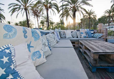 nautic: PALMA DE MALLORCA, BALEARIC ISLANDS, SPAIN - DECEMBER 22, 2015: Cozy nautical style sofa outdoors in the Boat House restaurant on December 22, 2015 in Palma de Mallorca, Balearic islands, Spain Editorial