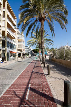 bicycling: CAN PASTILLA, BALEARIC ISLANDS, SPAIN - DECEMBER 22, 2015: Seaside bicycling route in Can Pastilla on a sunny day on December 22, 2015 in Can Pastilla, Balearic islands, Spain