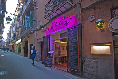 carrer: PALMA DE MALLORCA, BALEARIC ISLANDS, SPAIN - APRIL 7, 2016: Sazon Restaurant on Carrer des Apuntadores in Palma de Mallorca, Balearic islands, Spain on April 7, 2016.