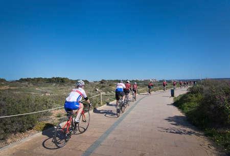 bicyclists: PALMA DE MALLORCA, BALEARIC ISLANDS, SPAIN - APRIL 10, 2016: Group of bicyclists practice through Es Carnatge outside Palma de Mallorca, Balearic islands, Spain on April 10, 2016. Editorial