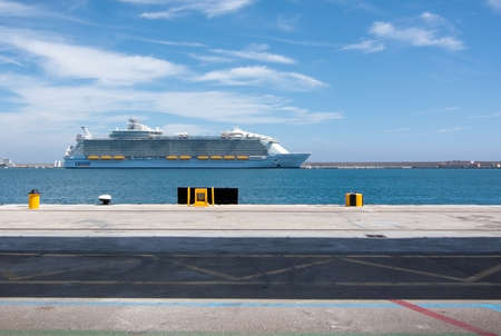 seas: PALMA DE MALLORCA, BALEARIC ISLANDS, SPAIN - JUNE 13, 2016: Harmony of the Seas, the largest cruise ship in the world moored in the Palma harbor on June 13, 2016 in Palma de Mallorca, Balearic islands, Spain. Editorial