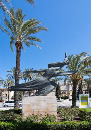 paseo: PALMA DE MALLORCA, BALEARIC ISLANDS, SPAIN - APRIL 13, 2016: Public art stone sculpture Spirit of the islands, Genie de les Illes, in a park on Paseo Maritimo in Palma de Mallorca, Balearic islands, Spain on April 13, 2016.