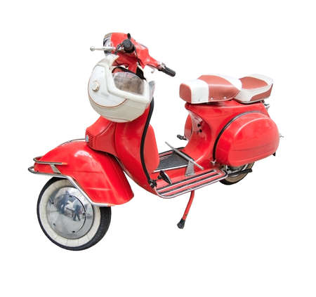 Red vintage vespa with helmet isolated on white.