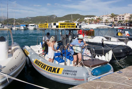 PORT ANDRATX, MALLORCA, SPAIN - AUGUST 5, 2016: Water taxi arrived in port on a sunny summer day in August 5 in Port Andratx, Mallorca, Spain.