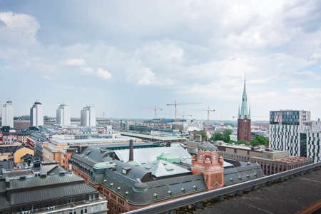 highrises: STOCKHOLM, SWEDEN - JUNE 3, 2016: High angle cityscape with highrises and medieval churches in Stockholm, Sweden on June 3, 2016. Editorial