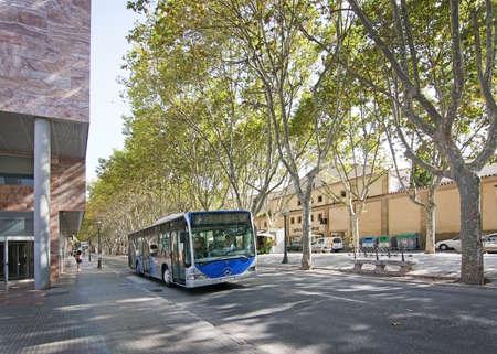 rambla: PALMA, MALLORCA, SPAIN - AUGUST 29, 2016: Bus on La Rambla on a sunny summer day on August 29, 2016 in Palma, Mallorca, Spain. Editorial