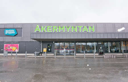 precipitation: HASSELBY, STOCKHOLM, SWEDEN - MARCH 22, 2016: Akermyntan shopping center entrance on a gray morning with snow coming down on March 22, 2016 in Hasselby, Stockholm, Sweden.