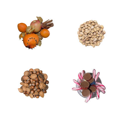 goodies: Christmas goodies nuts and candy decorations in bowls isolated on white