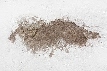 roughcast: White roughcast wall with area of flaked paint grungy rustic background.