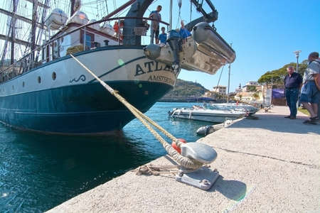 brigg: PUERTO SOLLER, MALLORCA, SPAIN - OCTOBER 2, 2016: Three masted brigg Atlantis of Amsterdam gets ready for departure with crew in port on a sunny day on October 2, 2016 in Puerto Soller, Mallorca, Spain. Editorial