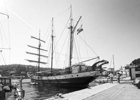 PUERTO SOLLER, MALLORCA, SPAIN - OCTOBER 2, 2016: Three masted brigg Atlantis of Amsterdam gets ready for departure with crew in port on a sunny day on October 2, 2016 in Puerto Soller, Mallorca, Spain. Editorial