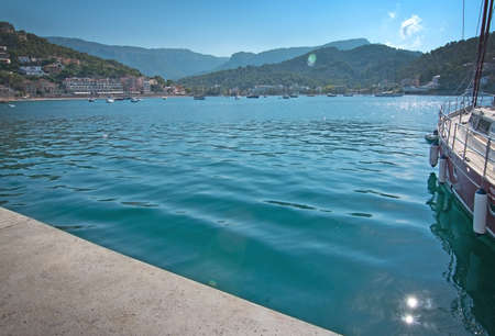 PUERTO SOLLER, MALLORCA, SPAIN - OCTOBER 2, 2016: Marina green water and boat on a sunny day on October 2, 2016 in Puerto Soller, Mallorca, Spain. Editorial