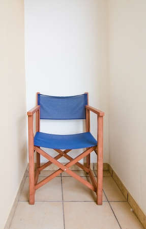 balearic: Blue brown directors chair with copy space, Balearic islands, Spain.