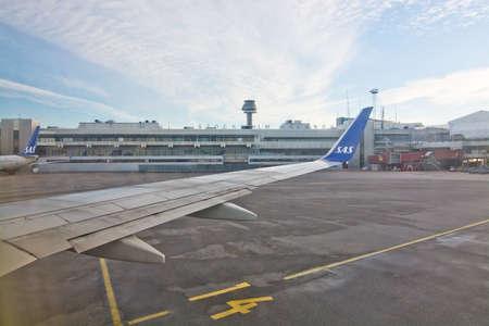 december 25: STOCKHOLM, SWEDEN - DECEMBER 25, 2016: Scandinavian Airlines jetliners line up outside the gates at the Stockholm Arlanda International airport on December 25, 2016 in Stockholm, Sweden. Editorial