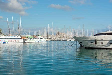 palma: PALMA DE MALLORCA, SPAIN - DECEMBER 11, 2016: Beautiful white yachts and boats moored in the marina on a sunny day on December 11, 2016 in Palma de Mallorca, Spain.