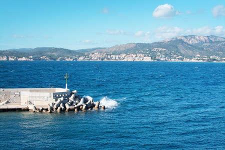mallorca: SANTA PONSA, MALLORCA, BALEARIC ISLANDS, SPAIN - JANUARY 12, 2017: Santa Ponsa nautic club inlet stone jetty on a sunny day on January 12, 2017 in Santa Ponsa, Mallorca, Balearic islands, Spain.