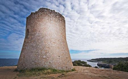 Cala Pi tower and ocean view horizon towards Cabrera island Mallorca, Spain.