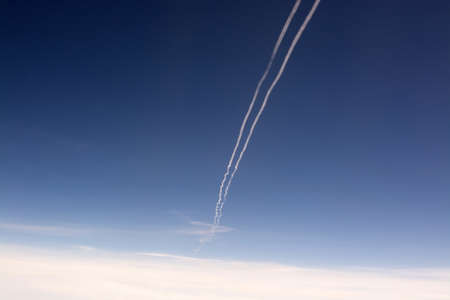 Blue sky and contrail aerial view in flight.