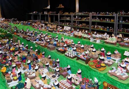 artisanry: PALMA DE MALLORCA, BALEARIC ISLANDS, SPAIN - DECEMBER 3, 2016: Miniature figurines in vendor booth in the Plaza Mayor Christmas market  on December 3, 2016 in Palma de Mallorca, Balearic islands, Spain.