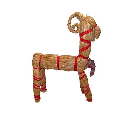 Bast straw Christmas goat holiday decoration isolated on white black. Stock Photo