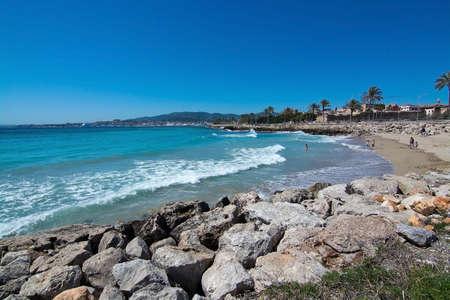 mallorca: PALMA DE MALLORCA, BALEARIC ISLANDS, SPAIN - APRIL 10, 2016: Palma beach next to bicycle route in Palma de Mallorca, Balearic islands, Spain on April 10, 2016. Editorial