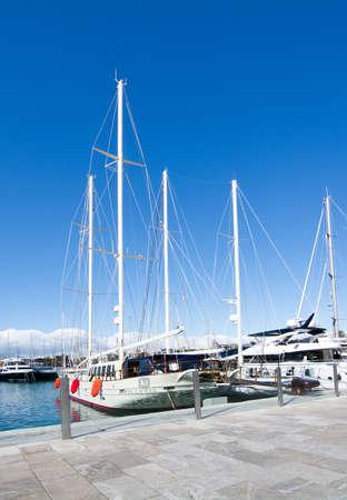 MALLORCA, BALEARIC ISLANDS, SPAIN - NOVEMBER 8 2017: Yachts moored in Palma port Moll Vell on a sunny day on November 8, 2017 in Mallorca, Balearic islands, Spain.