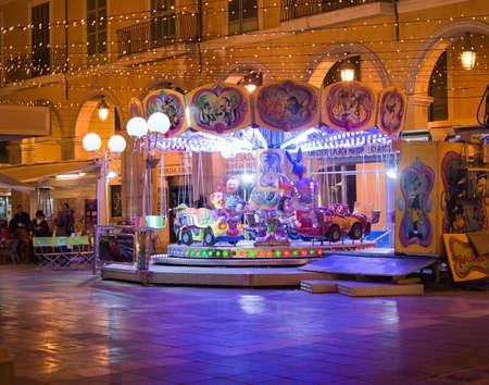 PALMA DE MALLORCA, BALEARIC ISLANDS, SPAIN - DECEMBER 5, 2017: Carousel at Plaza Mayor with evening Christmas light decorations on December 5, 2017 in Palma de Mallorca, Balearic islands, Spain. Editorial
