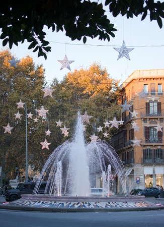PALMA DE MALLORCA, BALEARIC ISLANDS, SPAIN - DECEMBER 5, 2017: Plaza de la Reina fountain with Christmas light decorations on December 5, 2017 in Palma de Mallorca, Balearic islands, Spain.
