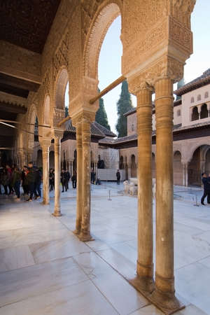 GRANADA, ANDALUCIA, SPAIN - DECEMBER 21, 2017: Alhambra Lions Court interior architectural details on December 21, 2017 in Granada, Andalucia, Spain Editorial