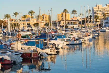 PALMA DE MALLORCA, SPAIN - JANUARY 4, 2018: Portixol marina moored boats in afternoon sunshine on January 4, 2018 in Palma de Mallorca, Spain.