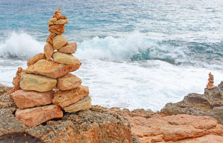 Cairns manmade stone towers at Cap de Ses Salines on the southern tip of Majorca.