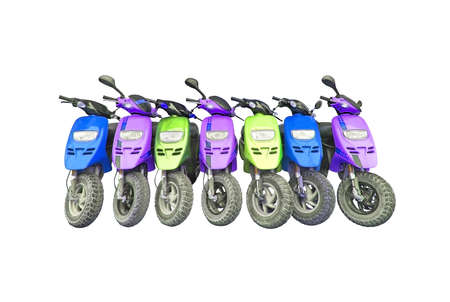 Seven scooters in blue, yellow and red colors packed isolated on white.