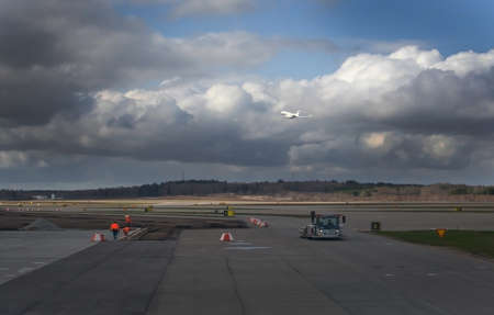 STOCKHOLM, SWEDEN - APRIL 27, 2018: Arlanda airport tarmac and small white government aircraft with three crowns symbol leaves
