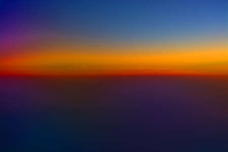 Abstract rainbow colors flight image at sunrise in the ocean