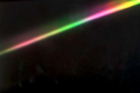 Abstract diagonal rainbow color light streak on black Stock Photo