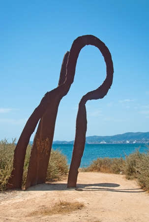 PALMA DE MALLORCA, SPAIN - JULY 21, 2012: Rusty iron sculpture in Es Carnatge on a sunny summer day on July 21, 2012 in Mallorca, Spain.