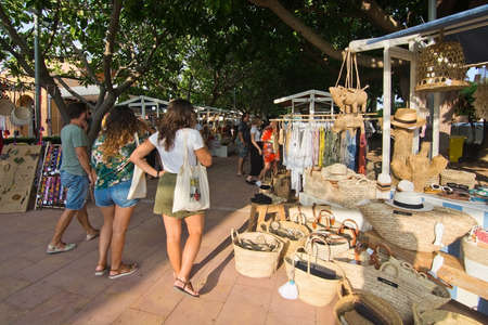 MALLORCA, SPAIN - AUGUST 30, 2018: Vendors and visitors at the Sunset Market in Puerto Portals on a late summer sunny afternoon on August 30, 2018 in Mallorca, Spain Editorial